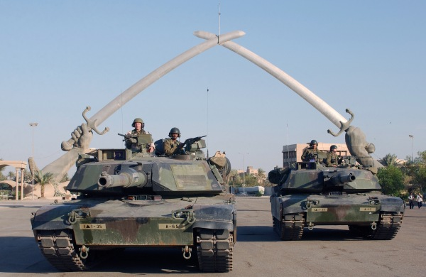 U.S. soldiers in tanks at the Hands of Victory monument in Baghdad